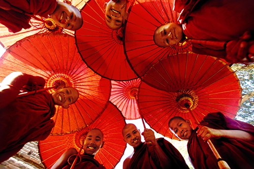 Monk boys with umbrellas in Pagan, Myanmar
